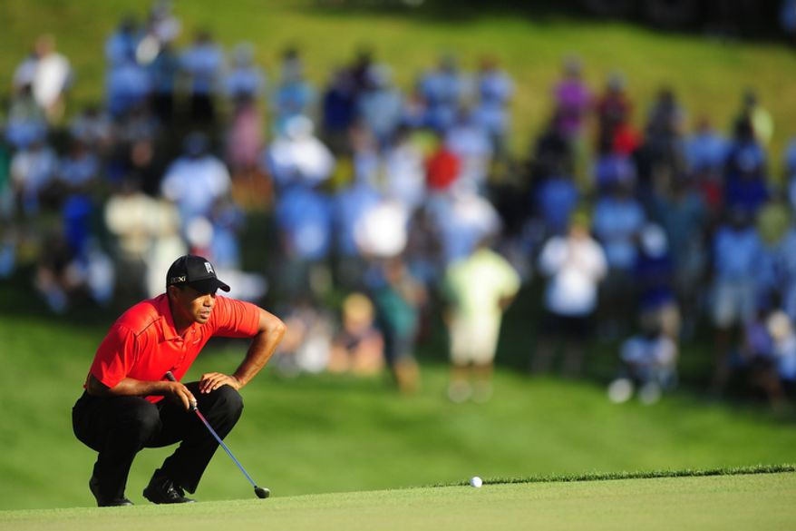 Tiger Woods lines up a putt on the seventeenth hole at Congressional Country Club during final round play of the AT&T National golf tournament, Bethesda, Md., Sunday, July 1, 2012.  (Ryan M.L. Young/The Washington Times)