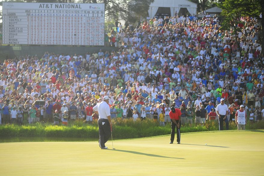 Tiger Woods putts on the eighteenth green at Congressional Country Club during final round play of the AT&T National golf tournament, Bethesda, Md., Sunday, July 1, 2012.  (Ryan M.L. Young/The Washington Times)