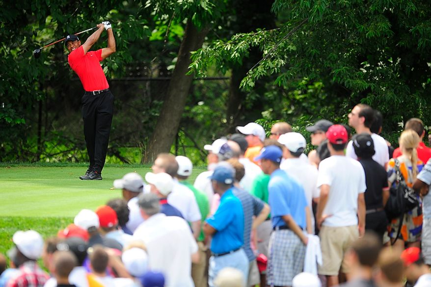 Tiger Woods tees off on the fifth hole at Congressional Country Club during final round play of the AT&T National golf tournament, Bethesda, Md., Sunday, July 1, 2012.  (Ryan M.L. Young/The Washington Times)