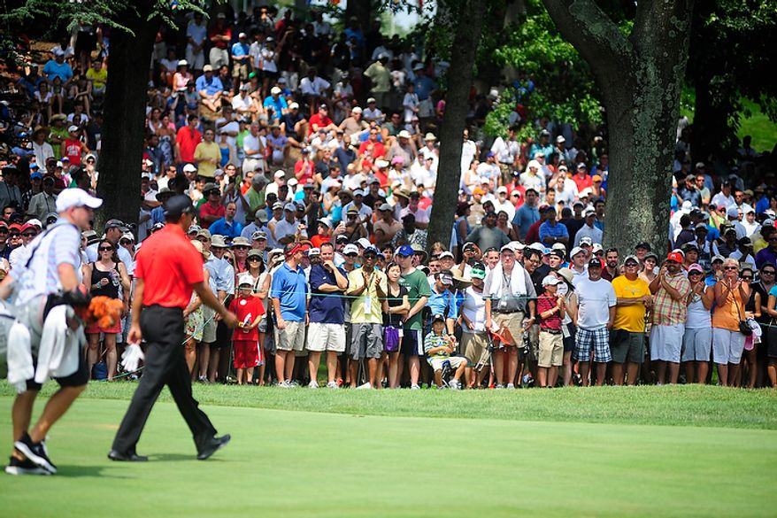 Large crowds greet Tiger Woods as he walks towards the sixth green at Congressional Country Club during final round play of the AT&T National golf tournament, Bethesda, Md., Sunday, July 1, 2012.  (Ryan M.L. Young/The Washington Times)