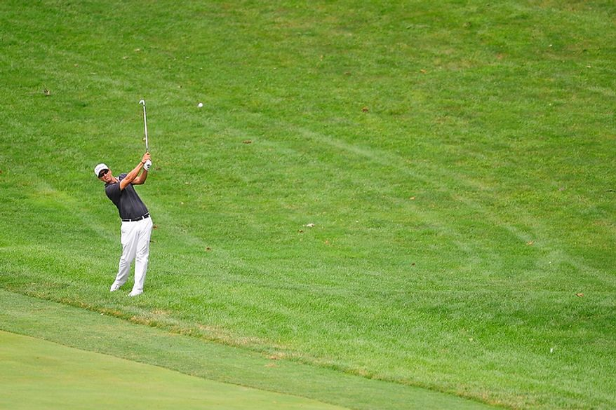 Adam Scott hits an approach shot on the fourteenth hole at Congressional Country Club during final round play of the AT&T National golf tournament, Bethesda, Md., Sunday, July 1, 2012.  (Ryan M.L. Young/The Washington Times)