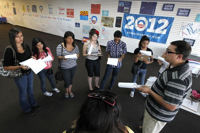 Brian Conklin (far right), a regional campaign director for the re-election of President Obama, briefs volunteers about registering new voters prior to them canvassing a heavily Latino neighborhood in Phoenix. Across the country both political parties have been courting the Latino vote, the nation's fastest-growing minority group. (AP Photo/Ross D. Franklin)