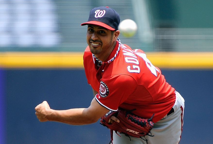 Washington Nationals starting pitcher Gio Gonzalez throws to the Atlanta Braves in the first inning of their baseball game on Sunday, July 1, 2012, at Turner Field in Atlanta. Gonzalez is one of three Nationals players who were chosen to the All-Star team. (AP Photo/David Tulis)