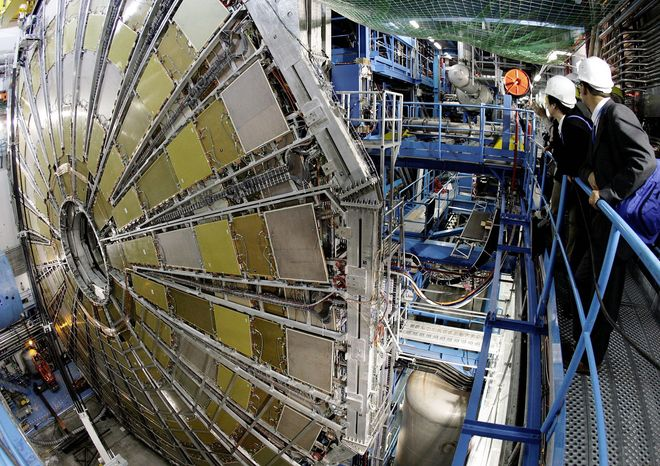Spectators look at the ATLAS detector construction (a Toroidal LHC Apparatus) at the CERN (Centre Europeen de Recherche Nucleaire) near Geneva, Switzerland, Thursday, May 31, 2007. The detector will be placed around the large hadron collider (LHC), CERN's highest energy particle accelerator. ATLAS is a general-purpose detector designed to measure the broadest possible range of