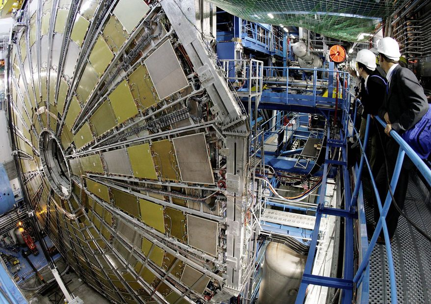 Spectators look at the ATLAS detector construction (a Toroidal LHC Apparatus) at the CERN (Centre Europeen de Recherche Nucleaire) near Geneva, Switzerland, Thursday, May 31, 2007. The detector will be placed around the large hadron collider (LHC), CERN's highest energy particle accelerator. ATLAS is a general-purpose detector designed to measure the broadest possible range of particles and physical processes that could result from the collision of the proton beams within the LHC. A pilot run of the LHC is scheduled for summer 2007. (AP Photo/KEYSTONE/Martial Trezzini)