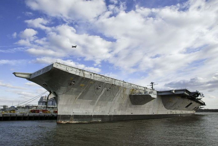 The aircraft carrier USS America was towed out to sea in 2005 on her final voyage. Hundreds of miles off the Atlantic coast, Navy personnel blasted the warship with missiles and bombs until it sank. The Navy is resuming the sinking exercises after a moratorium spurred by environmental and cost concerns. (Associated Press)