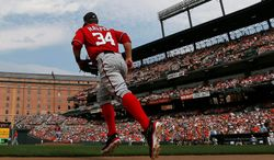 Nationals outfielder Bryce Harper has become a phenomenon since making his major league debut Apri 28. Whether bonking his head with a bat, rifling off snappy one-liners or showing off his prodigious skills, the rookie has become one of most-talked about players in the majors. (Associated Press)