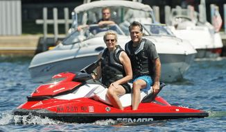 Republican presidential hopeful Mitt Romney and wife Ann enjoy a break from the campaign trail near the family compound on Lake Winnipesaukee in Wolfeboro, N.H., on Monday. (Associated Press)