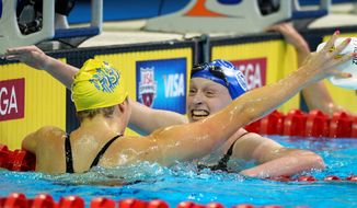 Katie Ledecky of Bethesda celebrates with Kate Ziegler ( left) of Great Falls after winning the women's 800-meter freestyle final at the U.S. Olympic swimming trials Sunday. Ledecky will be going to her first Olympics, while Ziegler will be experiencing the games for the second time. (Associated Press)