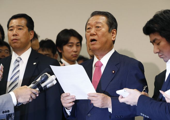 Japanese lawmaker Ichiro Ozawa reads a statement during a press conference in Tokyo on Monday, July 2, 2012, after he and 49 other lawmakers resigned from the ruling Democratic Party of Japan. (AP Photo/Shizuo Kambayashi)