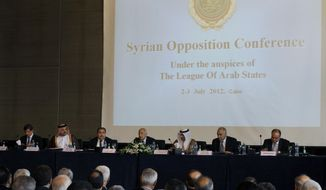 Attendees at an Arab League conference on Syria on Monday, July 2, 2012, in Cairo include (from left) Turkish Foreign Minister Ahmet Davutoglu; Khalid Al Attiya, Qatar minister of state for international cooperation; Iraqi Foreign Affairs Minister Hoshyar Zebari; Arab League Secretary-General Nabil Elaraby; Sheik Sabah Khalid Al Hamad Al Sabah, the Kuwaiti foreign minister; Egyptian Foreign Minister Mohammed Kamel Amr; and Palestinian envoy Nasser Al Qudwa. (AP Photo)