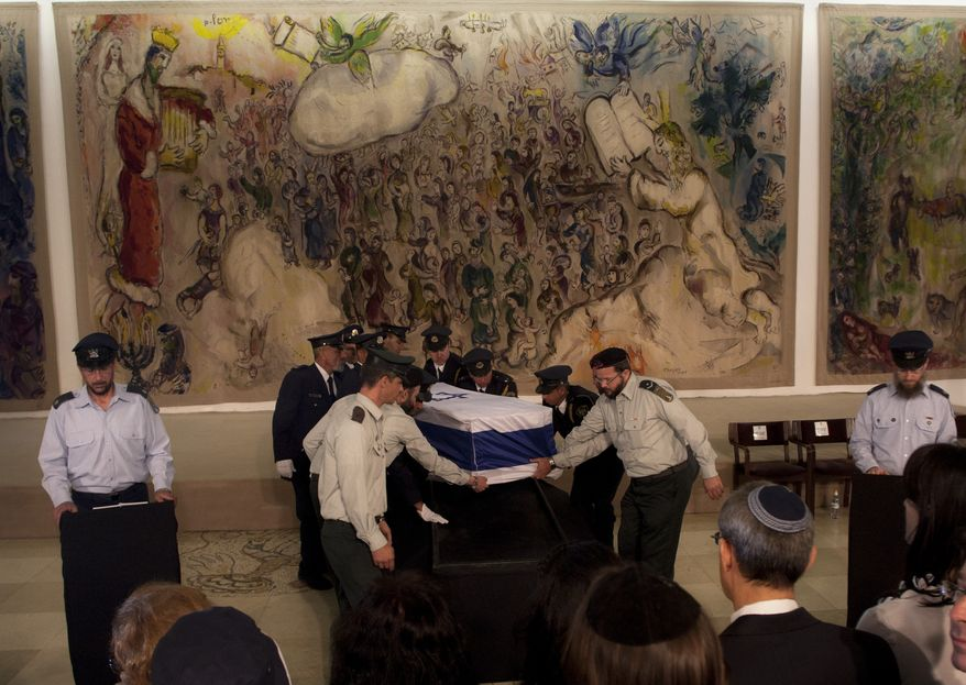 Israeli Knesset guard members carry the coffin of former Prime Minister Yitzhak Shamir during a ceremony at Israel's parliament in Jerusalem on Monday, July 2, 2012. The 96-year-old Mr. Shamir died Saturday. (AP Photo/Sebastian Scheiner)
