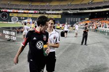 D.C. United player-assistant coach Josh Wolff shared a word with midfielder Lewis Neal after United's 3-0 win over Montreal at RFK Stadium on Saturday.  (Preston Keres/Special to The Washington Times)