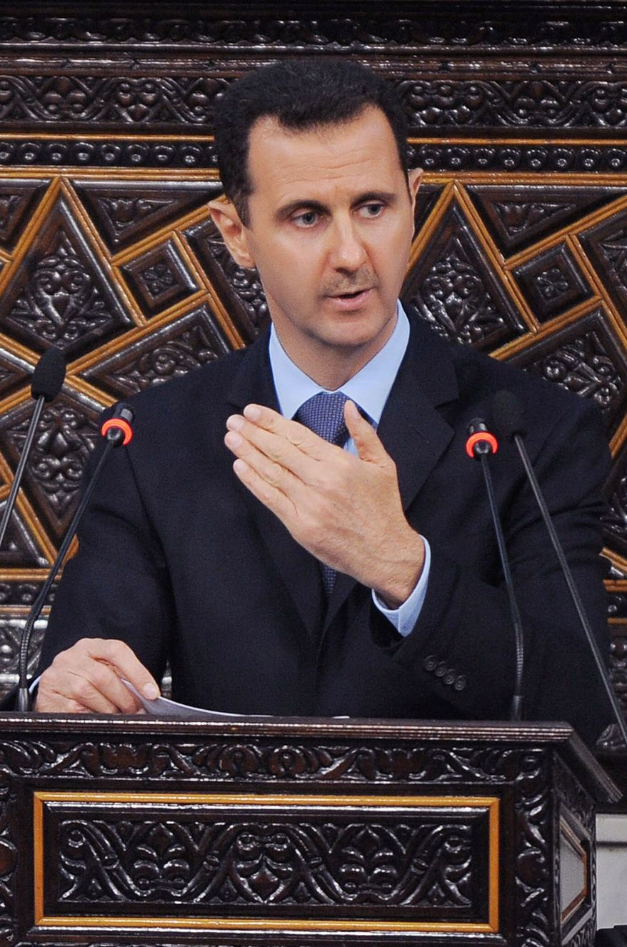 ** FILE ** In a March 30, 2011, file photo released by the Syrian official news agency SANA, Syrian President Bashar Assad, addresses the Parliament, in Damascus, Syria. A Turkish newspaper says Assad, speaking in an exclusive interview, has expressed regret over the shooting down of a Turkish jet by his forces. (AP Photo/SANA, file)