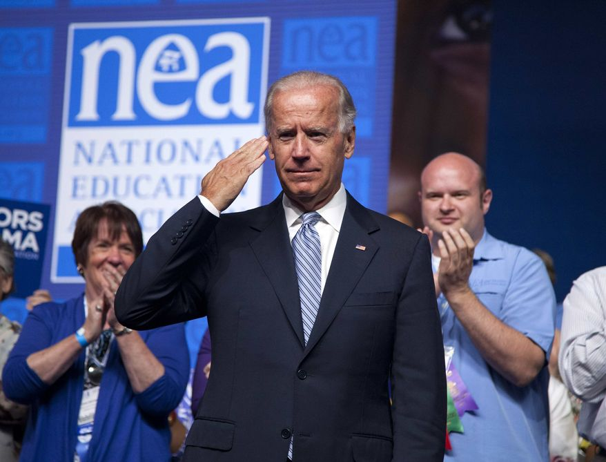 Vice President Joe Biden salutes after arriving to speak before the 2012 National Educational Association annual meeting, Tuesday, July 3, 2012, in Washington. (AP Photo/Evan Vucci)