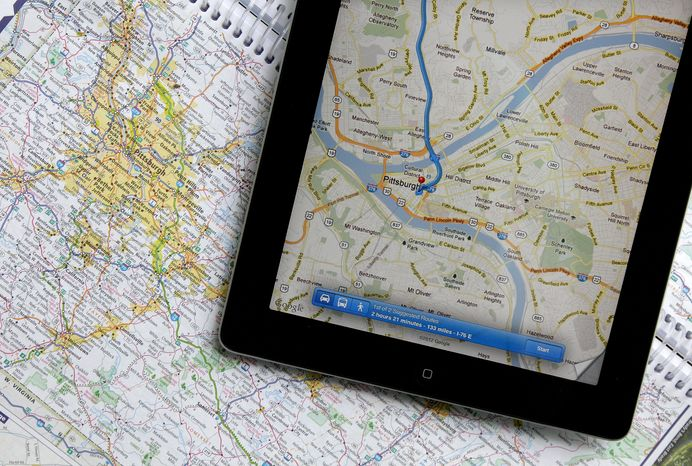 In this Tuesday, May 8, 2012 photo a traditional road map of the Pittsburgh area and one showing the same region on an iPad are seen placed together in Moreland Hills, Ohio. Transportation agencies around
