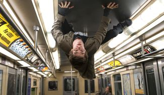 "Andrew Garfield portrays Peter Parker and Spider-Man in a scene from ""The Amazing Spider-Man."" (Associated Press/Columbia - Sony Pictures)"