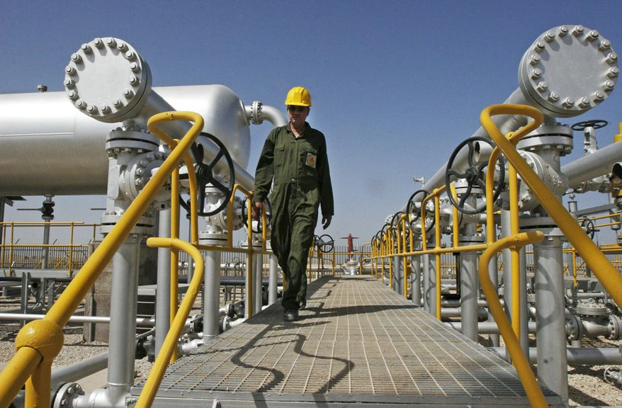 ** FILE ** In this Tuesday, April 15, 2008, file photo, Iranian oil technician Majid Afshari makes his way to the oil separator facilities in Iran's Azadegan oil field southwest of Tehran. (AP Photo/Vahid Salemi, File)
