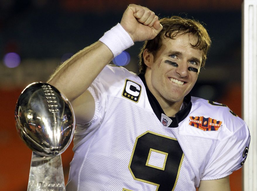 **FILE** New Orleans Saints quarterback Drew Brees celebrates Feb. 7, 2010, after the Saints' 31-17 win against the Indianapolis Colts in Super Bowl XLIV in Miami. (Associated Press)