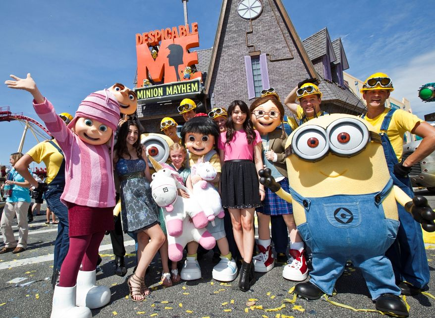 "This image released by Universal Orlando shows actresses with the characters they voiced from the animated film ""Despicable Me,"" from left, Dana Gaier with the character Edith, Elsie Fisher with Agnes and Miranda Cosgrove, who voiced Margo, at the grand opening of the 3-D ride ""Despicable Me Minion Mayhem,"" based on the animated film, Monday, July 2, 2012 in Orlando, Fla. (AP Photo/Universal Orlando)"