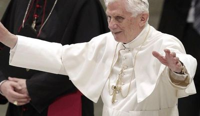 Pope Benedict XVI waves as he arrives for an audience with newly appointed archbishops at the Paul VI Audience Hall at the Vatican on Saturday, June 30, 2012. (AP Photo/Riccardo De Luca)