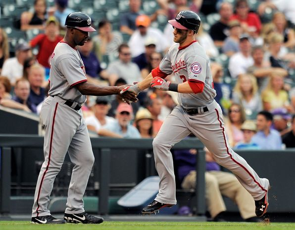 Washington's Bryce Harper was 11 months old when Chipper Jones made his major league debut in September 1993. They could be National League teammates in the All-Star Game if Harper gets in on the fans' vote. (Associated Press)
