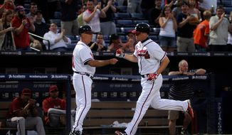 Forty-year-old Chipper Jones was named to the All-Star team as an injury replacement for Matt Kemp. Now, he has a chance to play with a young prodigy just like he was in Bryce Harper, if the rookie wins the final-spot vote. (Associated Press)