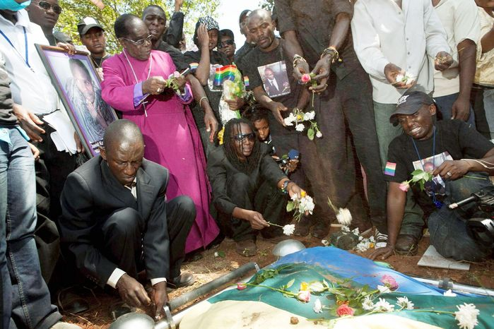 """People react during the funeral of Ugandan gay activist David Kato in Mukono, Uganda, in January 2011. His slaying followed the publication of his name and picture, and those of about 100 other suspected gays, in a tabloid under an inflammatory headline, """"Hang them."""" (Associated Press)"""