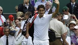 Roger Federer defeated Mikhail Youzhny in the Wimbledon quarterfinals, and he'll now face Novak Djokovic in a battle for the final. (AP Photo/Anja Niedringhaus)