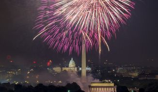 Fireworks can be seen as they explode over the National Mall to celebrate Independence Day, Arlington, Va., Wednesday, July 4, 2012. (Andrew Harnik/The Washington Times)