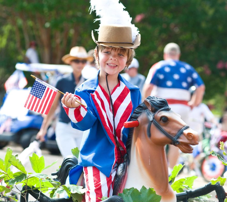 Cooper Eddleman is dressed as Yankee Doodle in the 4th of July parade in Oxford, Miss. (AP Photo/Oxford Eagle, Bruce Newman)