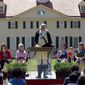 A re-enactor portraying George Washington speaks to candidates for naturalization during a naturalization ceremony at George Washington's Mount Vernon estate in Alexandria, Va. (AP Photo/Alex Brandon)