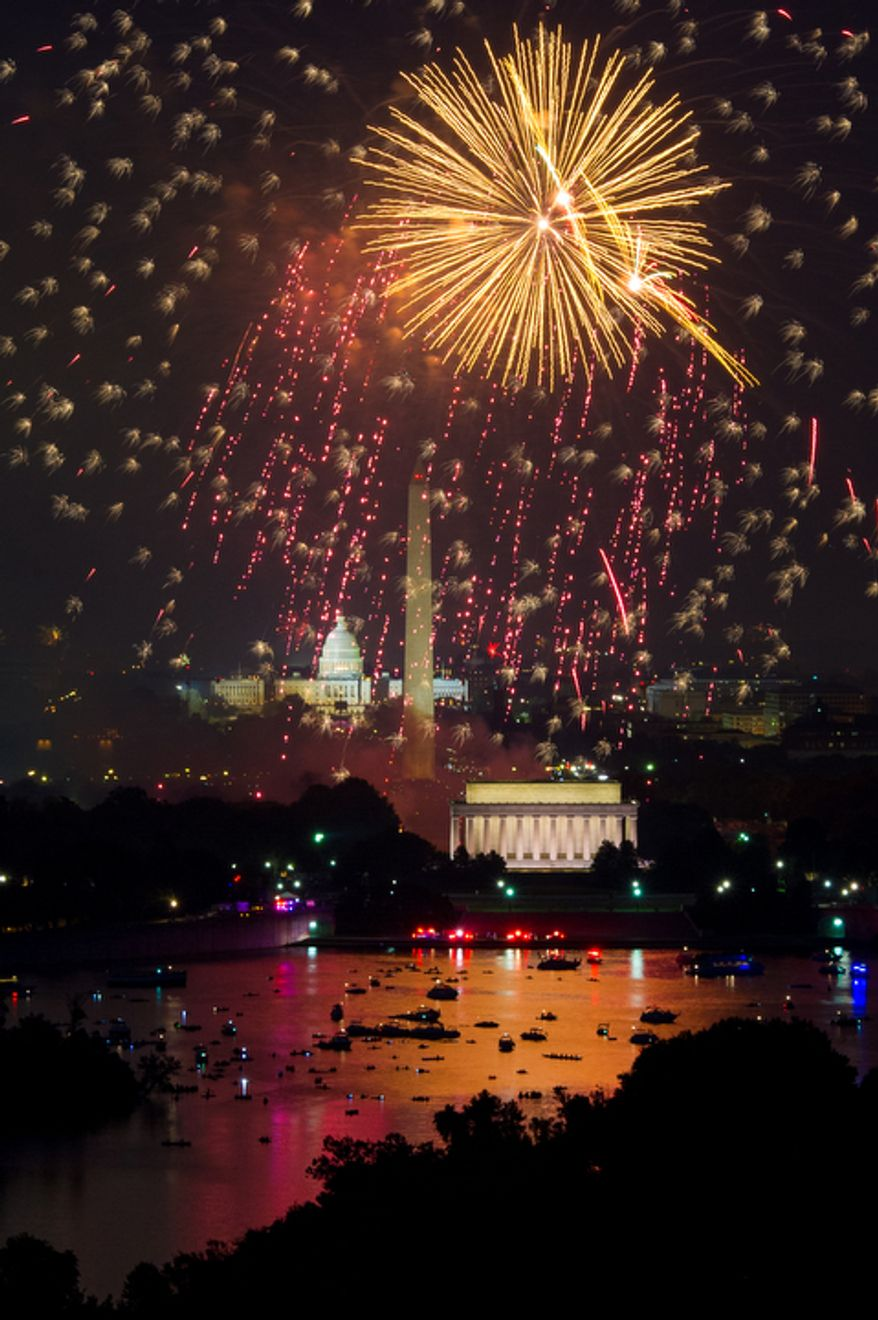 Fireworks can be seen from the Top of the Town as they explode over the National Mall to celebrate Independence Day, Arlington, Va., Wednesday, July 4, 2012. (Andrew Harnik/The Washington Times)