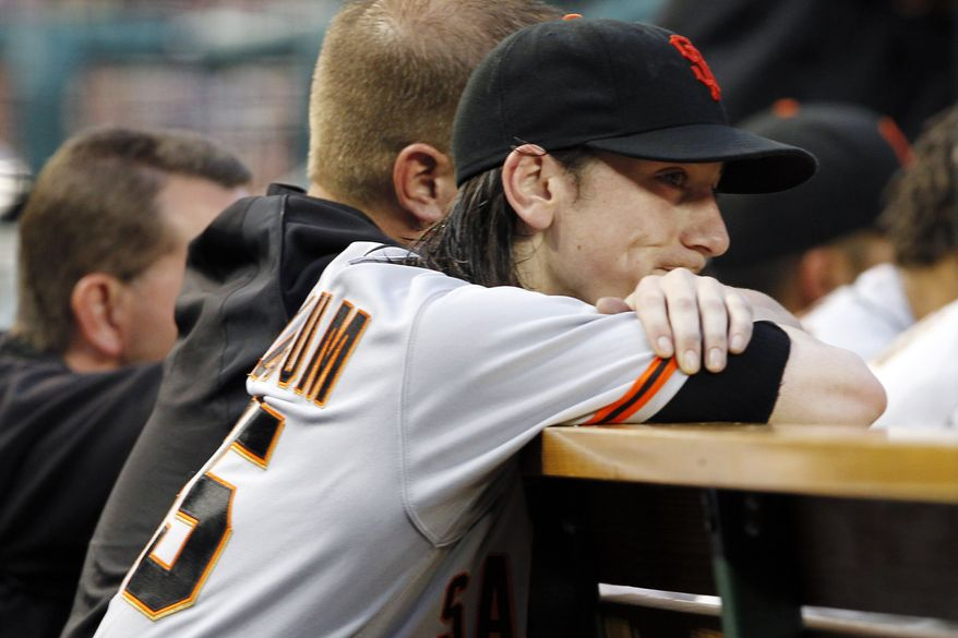 San Francisco Giants starting pitcher Tim Lincecum watches from the bench after he was pulled in the fourth inning of a baseball game with the Washington National, Tuesday, July 3, 2012, in Washington. (AP Photo/Alex Brandon)