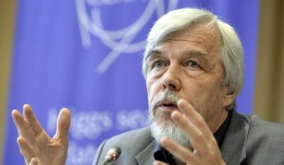 Rolf Heuer, director of the European Organization for Nuclear Research (CERN), answers questions July 4, 2012, during a scientific seminar in Meyrin, Switzerland, to deliver the latest update in the search for the Higgs boson. (Associated Press/Keystone)