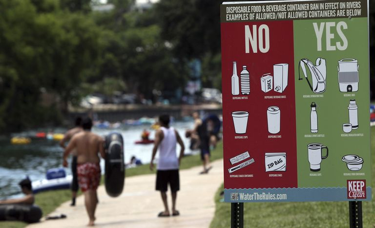 A sign informs Memorial Day visitors to Prince Solms Park in New Braunfels, Texas, on May 28, 2012, what is acceptable for tubers to carry down the Comal River. (Associated Press/San Antonio Express-News)