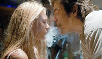 "Blake Lively and Benicio del Toro star in ""Savages,"" a violent return to the sleazy streets of pulp noir for veteran director Oliver Stone. (Universal Pictures via Associated Press)"