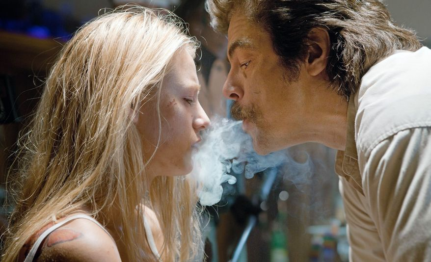 """Blake Lively and Benicio del Toro star in """"Savages,"""" a violent return to the sleazy streets of pulp noir for veteran director Oliver Stone. (Universal Pictures via Associated Press)"""