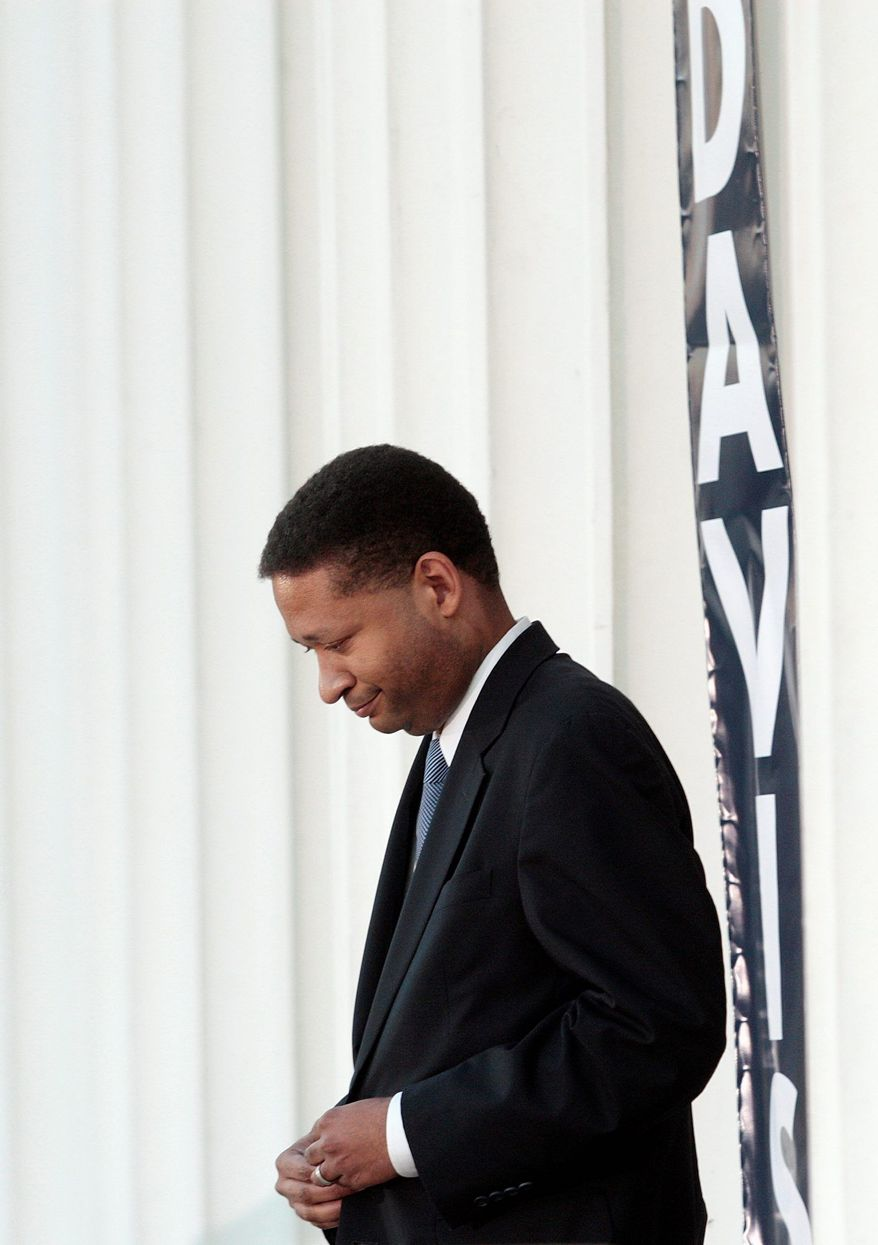 """Artur Davis, a onetime Democratic representative from Alabama, says his recent switch to the Republican Party was prompted by the massive chasm between President Obama's promises as a candidate and his results as president. """"The candidate who talked about and pledged to cut the deficit in half has now gotten us accustomed ... to trillion-dollar deficits every single year of his presidency,""""he said on a visit to Virginia. (Associated Press)"""