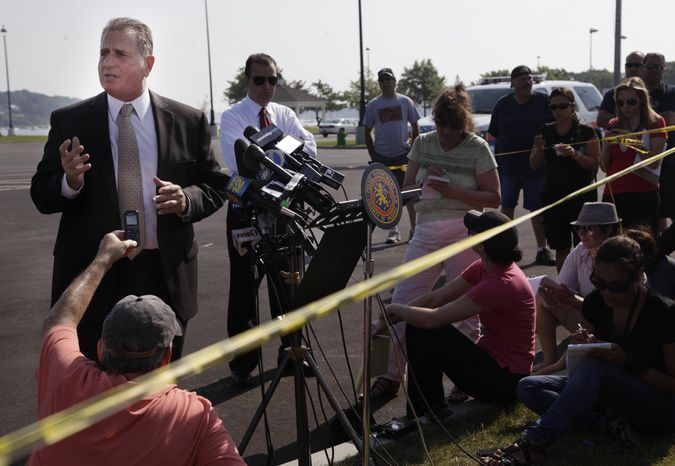 Detective Lt. John Azzata (left) of the Nassau County Police Department gives information about a fatal boating accident during a news conference in Oyster Bay, N.Y., on Thursday, July 5, 2012. (AP P