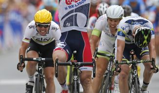 Andre Greipel of Germany crosses the finish line ahead of Mark Cavendish of Britain, left, Tom Veelers of The Netherlands, second right, and Matthew Harley Goss of Australia, right, to win the fifth stage of the Tour de France cycling race over 196.5 kilometers (122 miles) with start in Rouen and finish in Saint-Quentin, France, Thursday July 5, 2012. (AP Photo/Laurent Rebours