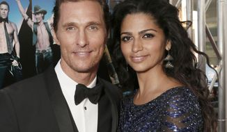 "Actor Matthew McConaughey and his wife, Camila Alves McConaughey, attend the premiere of ""Magic Mike"" at Regal Cinemas L.A. Live in Los Angeles on Sunday, June 24, 2012. (AP Photo/Todd Williamson, Invision)"