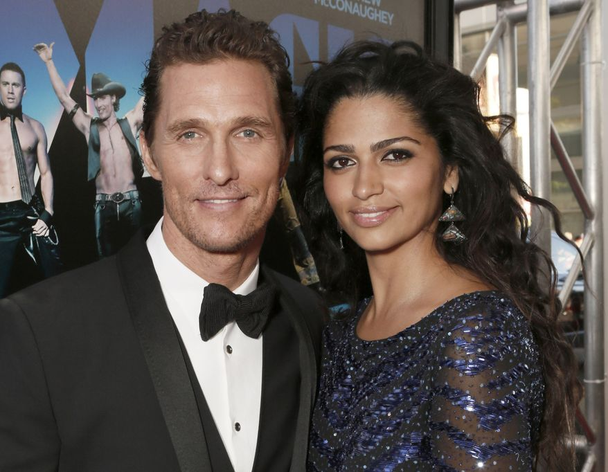 """Actor Matthew McConaughey and his wife, Camila Alves McConaughey, attend the premiere of """"Magic Mike"""" at Regal Cinemas L.A. Live in Los Angeles on Sunday, June 24, 2012. (AP Photo/Todd Williamson, Invision)"""