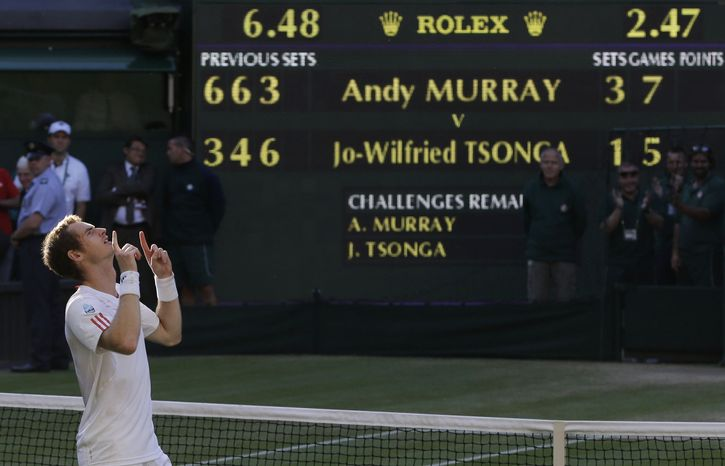 Andy Murray reacts after defeating Jo-Wilfried Tsonga in their semifinal match at the All England Lawn Tennis Championships at Wimbledon, England, Friday, July 6, 2012. Murray will play Rog