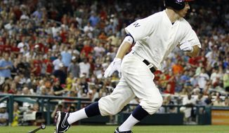 Washington Nationals' Adam LaRoche runs to first base after hitting a ground ball that scored Bryce Harper in the ninth inning of a baseball game against the San Francisco Giants to win 6-5, Thursday, July 5, 2012, in Washington. (AP Photo/Evan Vucci)