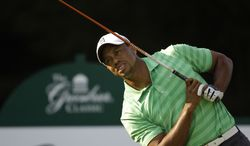 Tiger Woods reacts to his tee shot on the 12th hole during the second round of the Greenbrier Classic PGA Golf tournament at the Greenbrier in White Sulphur Springs, W. Va., Friday, July 6, 2012. (AP Photo/Steve Helber)