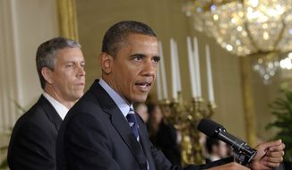 President Obama (right), with Education Secretary Arne Duncan at his side, calls on Congress during a June 21, 2012, news conference at the White House to stop interest rates on student loans from doubling. (Associated Press) ** FILE **