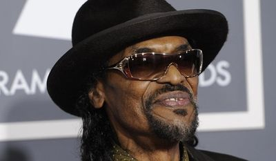 """** FILE ** In this Feb. 13, 2011 photo, Chuck Brown arrives at the 53rd annual Grammy Awards in Los Angeles. Brown, who styled a unique brand of funk music as a singer, guitarist and songwriter known as the """"godfather of go-go,"""" died Wednesday, May 16, 2012 after suffering from pneumonia. He was 75. (AP Photo/Chris Pizzello)"""