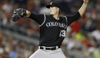 Colorado Rockies rookie starter Drew Pomeranz gave up just one hit in 6 1/3 innings with six strikeouts in the 5-1 defeat of the Washington Nationals on Friday night.   (AP Photo/Evan Vucci)