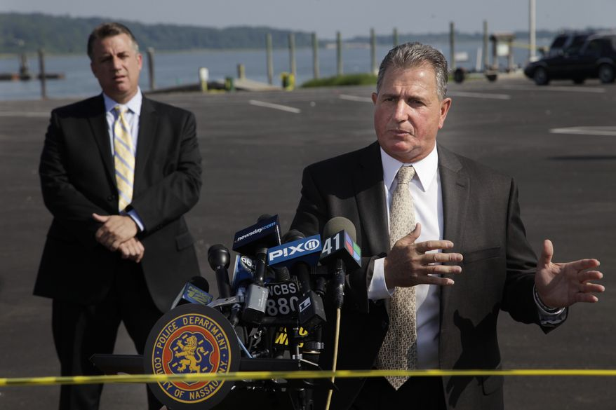 Nassau County Police Detective Lt. John Azzata, right, gives information about a fatal boating accident during a news conference in Oyster Bay, N.Y., Thursday, July 5, 2012. Police say three bodies have been pulled out of New York's Long Island Sound after a yacht capsized on the Fourth of July. (AP Photo/Seth Wenig)